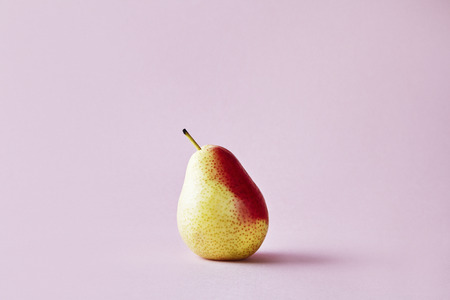 Fresh red pear on hipster pink background, modern style fruit and vegetable food, design layout