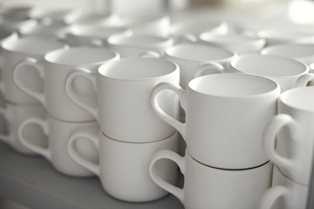 turn table: Blank ceramic cups, kiln Stock Photo