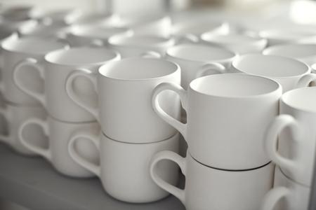 Blank ceramic cups, kiln Stock Photo