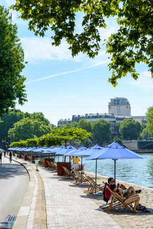 Paris, France - July 18, 2017: Every summer since 2002, Paris Plage event creates the environment of a seaside town, with artificial beaches, refreshment bars, terraces, parasols and deck chairs.
