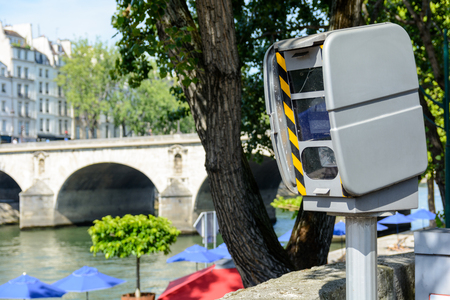 city limit: French traffic enforcement camera in the streets of Paris.