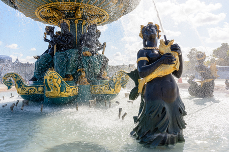 The Fountain of the Seas, on the Concorde place in Paris, with Nereids and Tritons holding golden fishes spouting water upwards to the vasque. Stock Photo