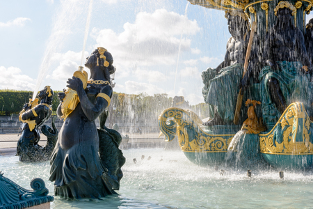 The Fountain of the Rivers, on the Concorde place in Paris, with Nereids and Tritons holding golden fishes spouting water upwards to the vasque. Stock Photo