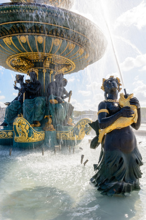 The Fountain of the Seas, on the Concorde place in Paris, with the statue of a Nereid holding golden fishes spouting water upwards to the vasque. Stock Photo