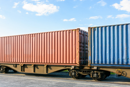 Two containers on a flat car train parked in a shipping yard in the region of Paris, France. Stock Photo