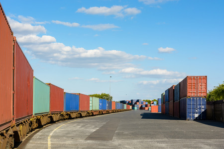flatcar: A train of containers parked in a shipping yard on the river Marne for the supply of supermarkets in Paris.