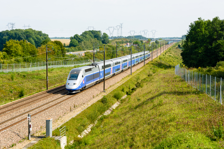 Moisenay, France - August 23, 2017: A double-decker high-speed TGV Duplex train driving north to Paris in the french countryside on the Lyon-Paris high-speed line. Editorial