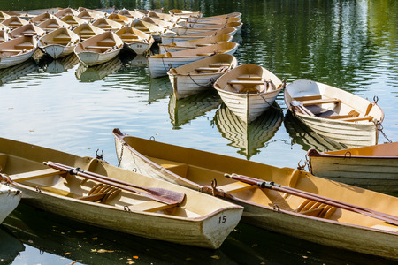 A fleet of rental rowboats bound to one another at the end of the day on the Lower Lake in the Bois de Boulogne in Paris.