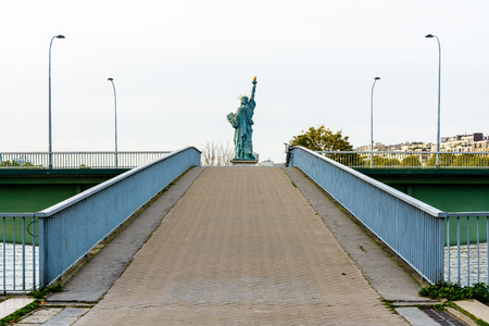 Symmetrical rear view of the replica of the Statue of Liberty in Paris.