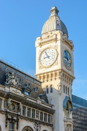 Paris, France - July 18, 2017: The wide clock tower overhanging the Paris Gare de Lyon railway station.
