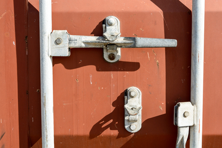 Closeup view of a worn intermodal container door locking system. Stock Photo