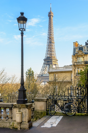 View of the Eiffel Tower from a small dead-end street of the Chaillot hill by a sunny winter afternoon.