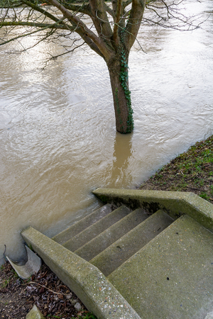 The stairs descending to the banks of the river Marne are flooded halfway up by the important rise in the water level.