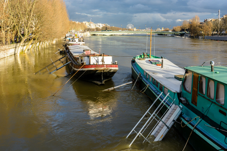 Houseboats docked at the Debilly port in Paris end up surrounded by flood water after the rise of the water level of the Seine during a winter flooding episode.