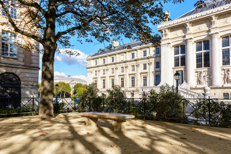 Rear entrance of the courthouse of Paris with the Chatelet theater in the background by a sunny evening.