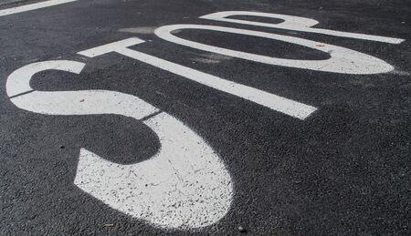 stop signal: Stop signal on asphalt