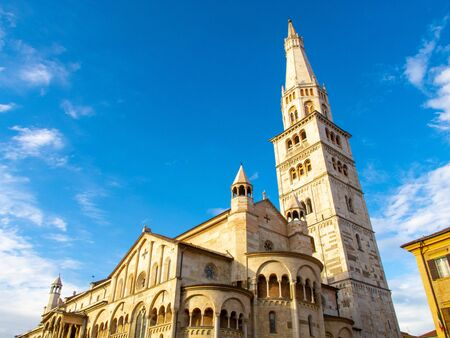 The Duomo of Modena and the characteristic Ghirlandina bell tower, Italy, against a background of the blue sky