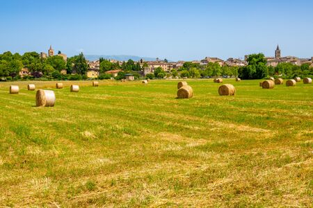 The small medieval town of Bevagna seen from the road in the middle of the Italian countryside
