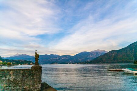 A seagull on a pier on lake Como at sunset, Italy