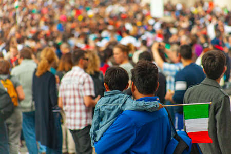 04/09/2014 - Rome, Italy: A man holds his son with a small Italian flag in the crowd