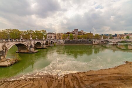 View of the Tiber river and Ponte Sant'Angelo, Rome, Italy