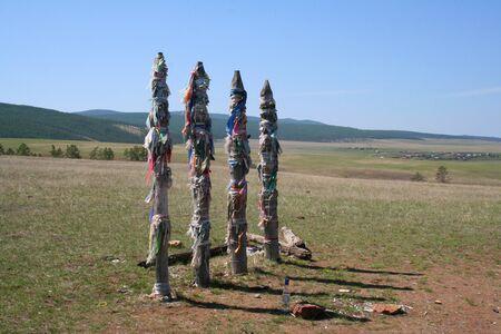 Traditional Buryat pagan sacred poles in the Olkhon Island. The Baikal lake. photo