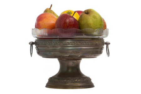 chased: Old chased copper vase with fruit isolate