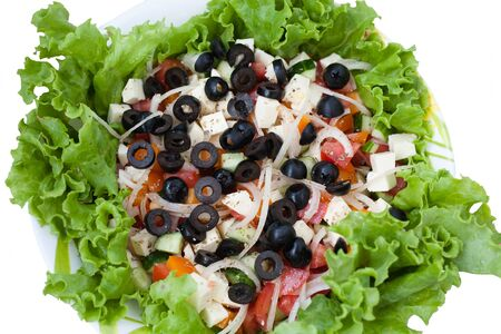 Greek salad with vegetables and cheese olives photo