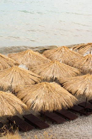 many thatched roof bungalows on the beach. photo