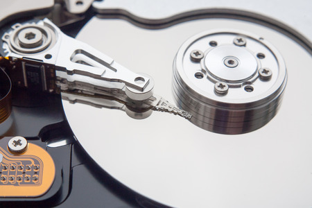scsi: The internal hard disk read head and the cylinder Stock Photo