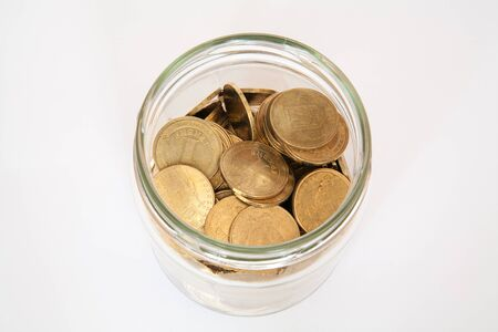 money jar: coin in money jar Stock Photo