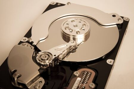 The internal hard disk read head and the cylinder Stock Photo