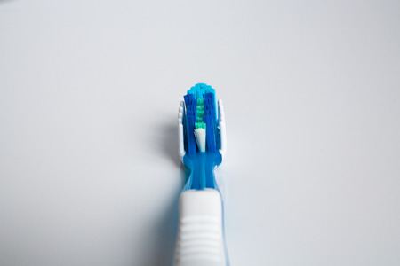 purge: beautiful and a new toothbrush in the studio on a white background