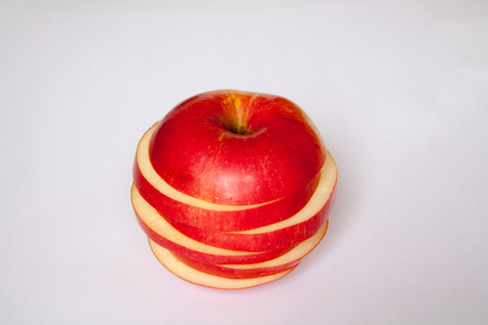 consciously: beautiful, consciously and tasty cut apple on a white background
