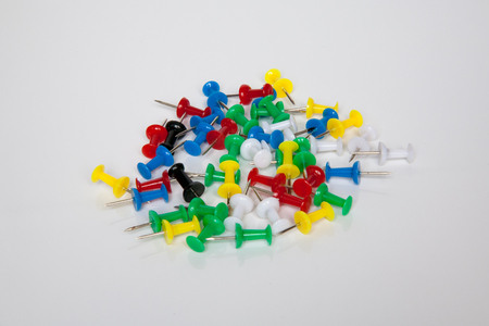 Set of push pins in different colors. Thumbtacks.On isolated background photo