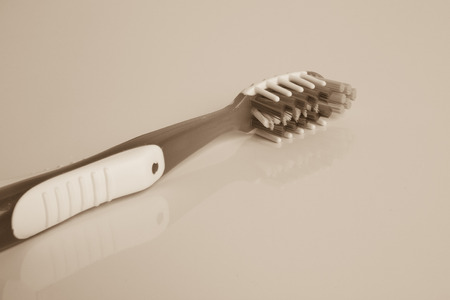 beautiful and a new toothbrush in the studio on a white background photo