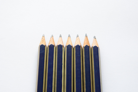 black pencil on a white background