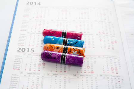 Woman hygiene protection, close-up.menstruation calendar with cotton tampons Stock Photo