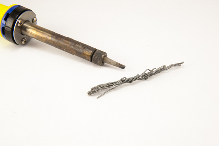 brazing: Yellow soldering tin on a white background