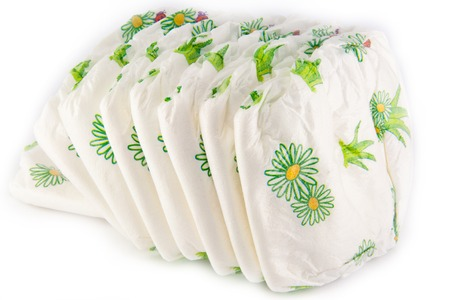 incontinence: Stack of diapers isolated on white background