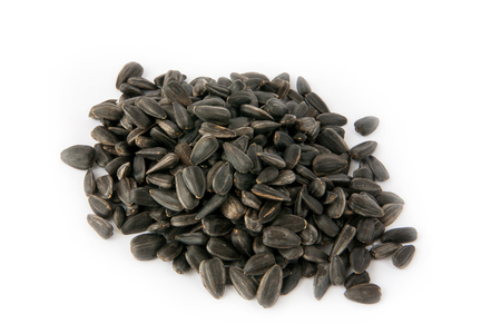 semen: a pile of sunflower seeds isolated Stock Photo