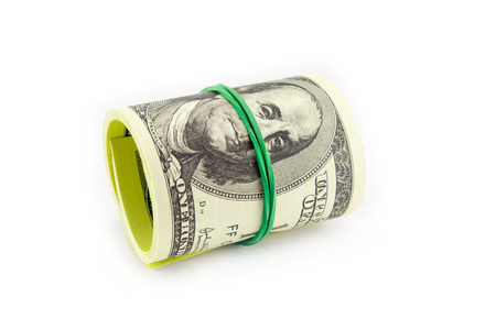 tightened: Dollar roll tightened with band. Rolled money isolated on white
