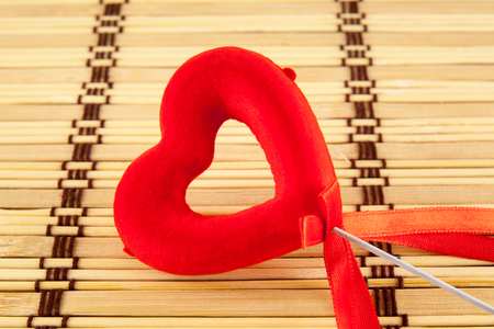lolly pop: Valentine day concept - heart shaped lolly pop on wood background. Top image. Stock Photo