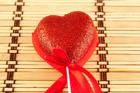 lolli: Valentine day concept - heart shaped lolly pop on wood background. Top image. Stock Photo