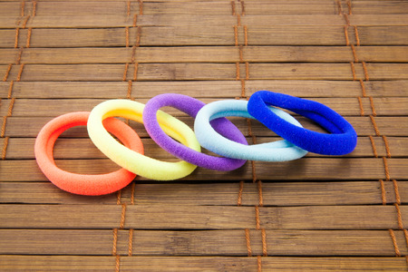 scrunchy: colored rubber bands for hair on the table Stock Photo