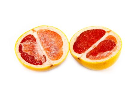 Juicy and tasty sliced greyafrut on a white background