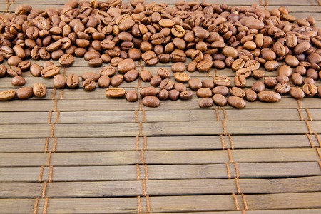 Coffee beans on vintage wooden board. Top image