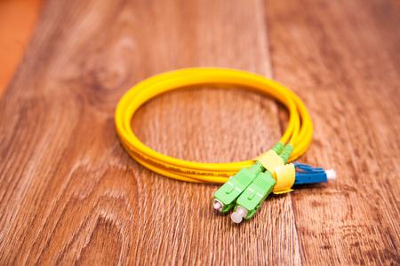 fiber optic patch cord on vintage background