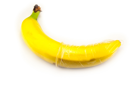 banana with condom isolated on white Banco de Imagens