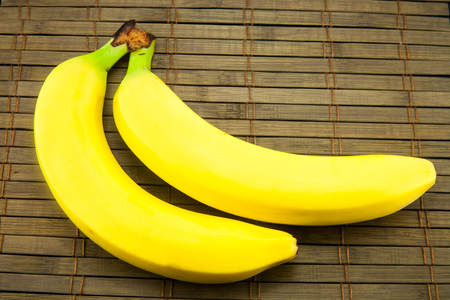 bananas isolated on wooden background. Top image.